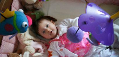 Photo d'un bébé dans son lit