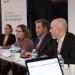 """Anne-Emmanuelle Grossi, Frédérique Penilla, Jacques bahi et Frédéric Muyard assis à une table de réunion devant une banière indiquant """"Conseil d'orientation stratégique"""""""